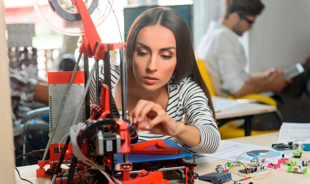 Capitalism leaves a woman to create products with a 3D printer.